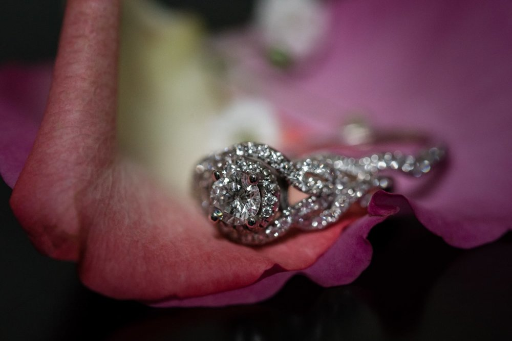 Photo of gorgeous wedding ring on flower in bridal suite.