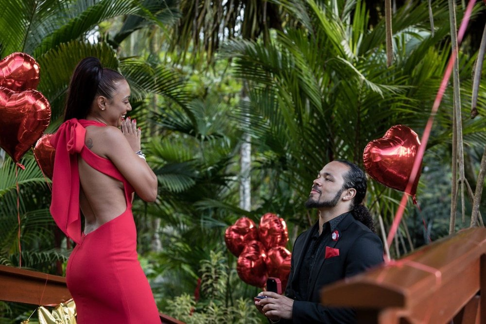 Man gets on his knee to ask his love to marry him in Costa Rica.