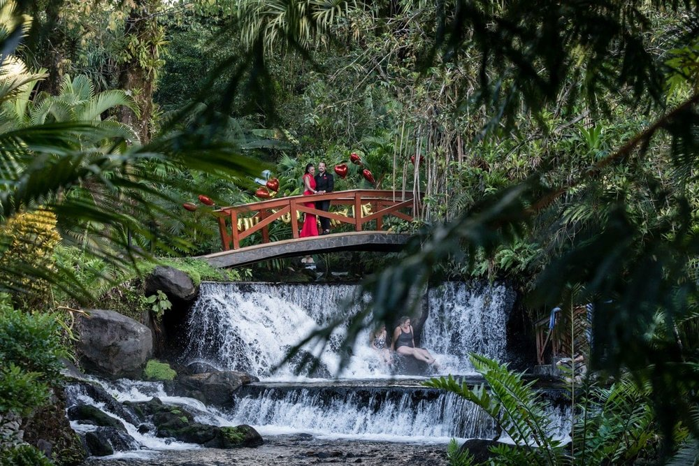 Fairly tale engagement waterfall scene at Tabacon Thermal Resort in Costa Rica.