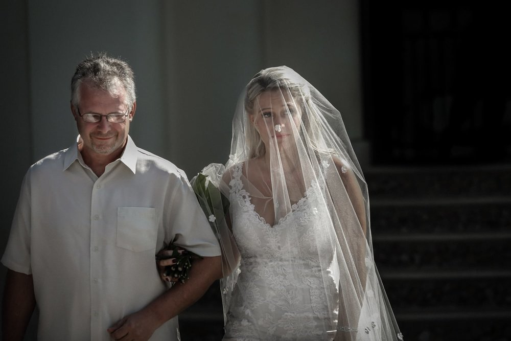 Father walks bride to altar on terrace at villa in Costa Rica.