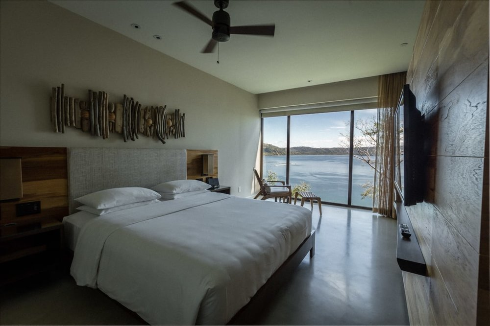 View of bedroom in standard guest suite with views.