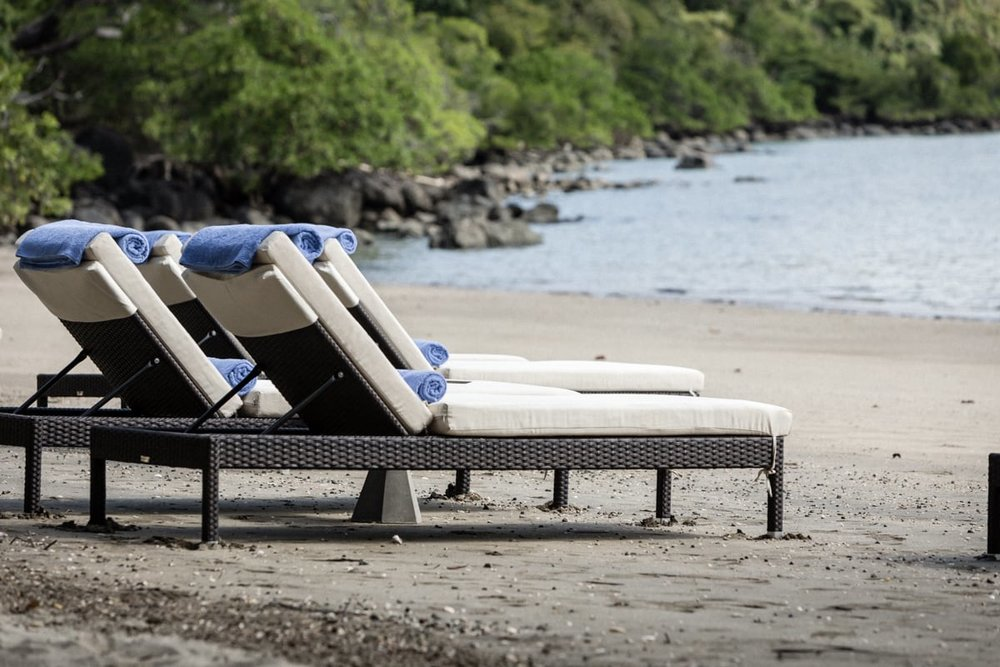 Lounge chairs on beach and beach wedding venue at Andaz, Costa Rica.