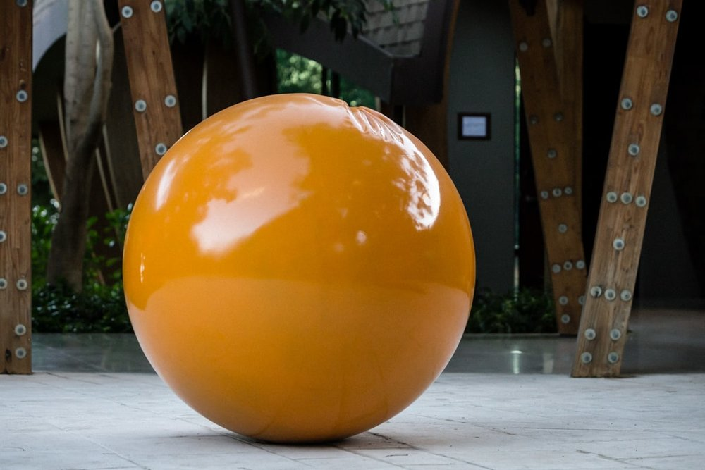 Wedding reception location at Andaz Resort decorated with large orange ball.