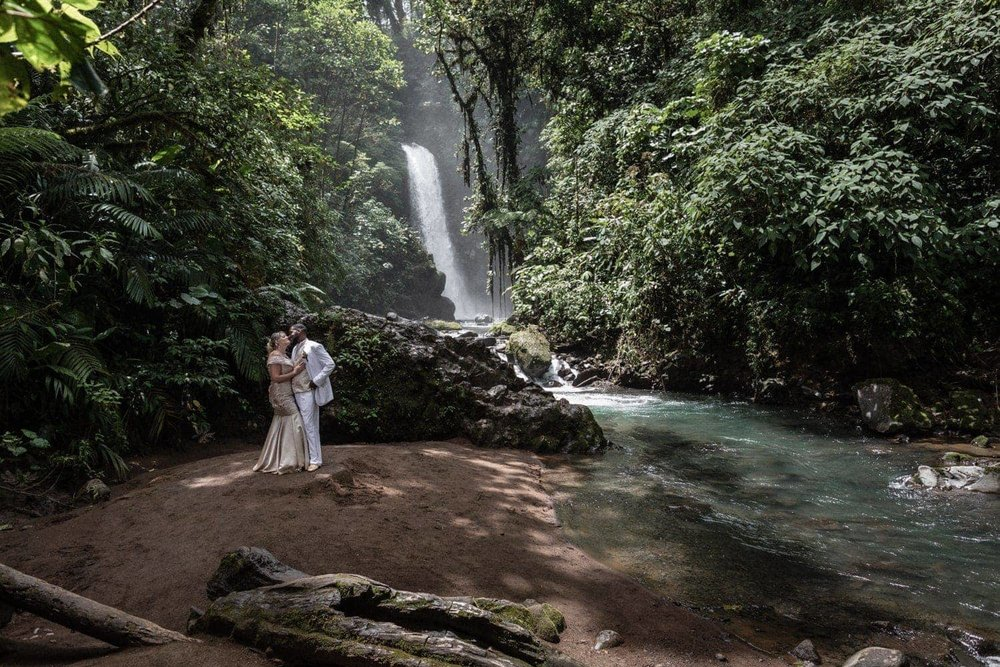 Bride and groom waterfall portrait at La Paz Waterfall Gardens.