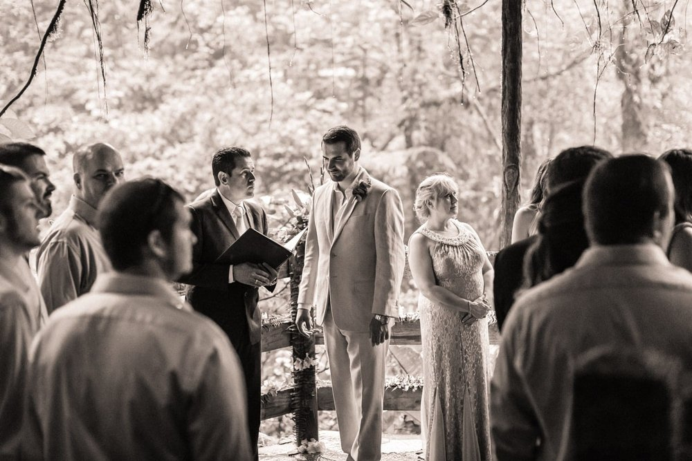 Black and white photo of wedding ceremony in cloud forest in Costa Rica.