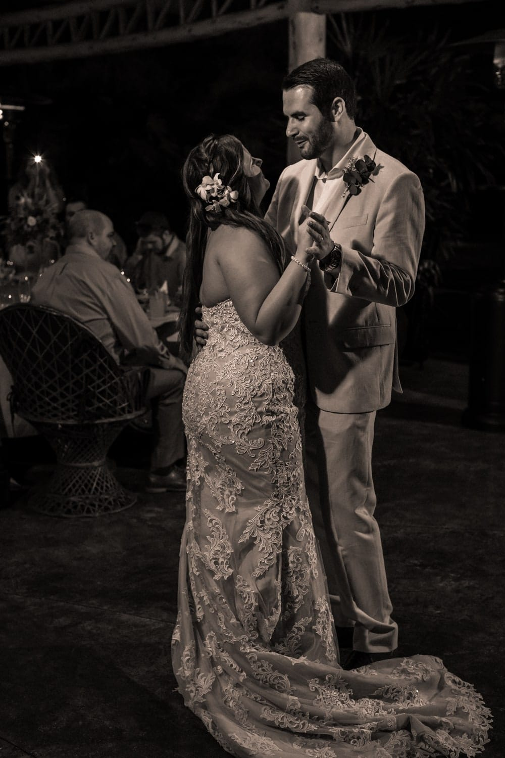 Black and white photo of groom during first dance.