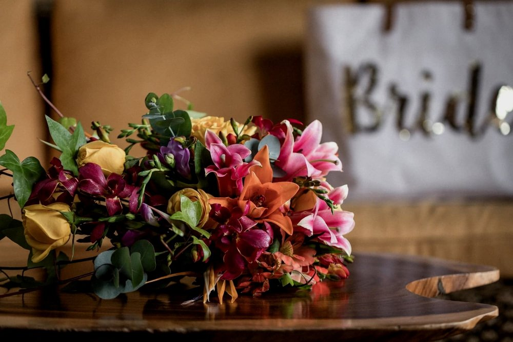 Bridal bouquet on coffee table in La Paz Waterfall Gardens suite.