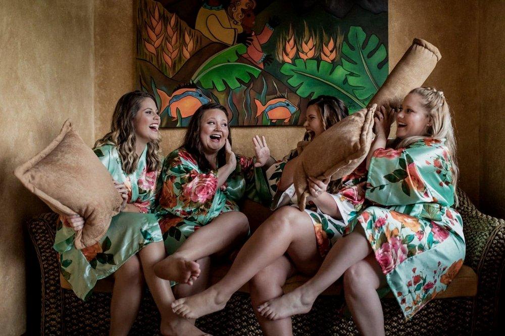 Bride and bridesmaids having fun before wedding ceremony.