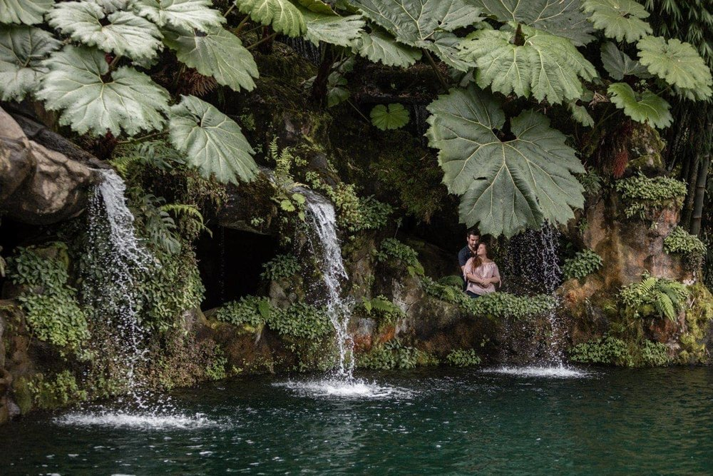 Tropical photo of couple during engagement session at La Paz Waterfall Gardens.