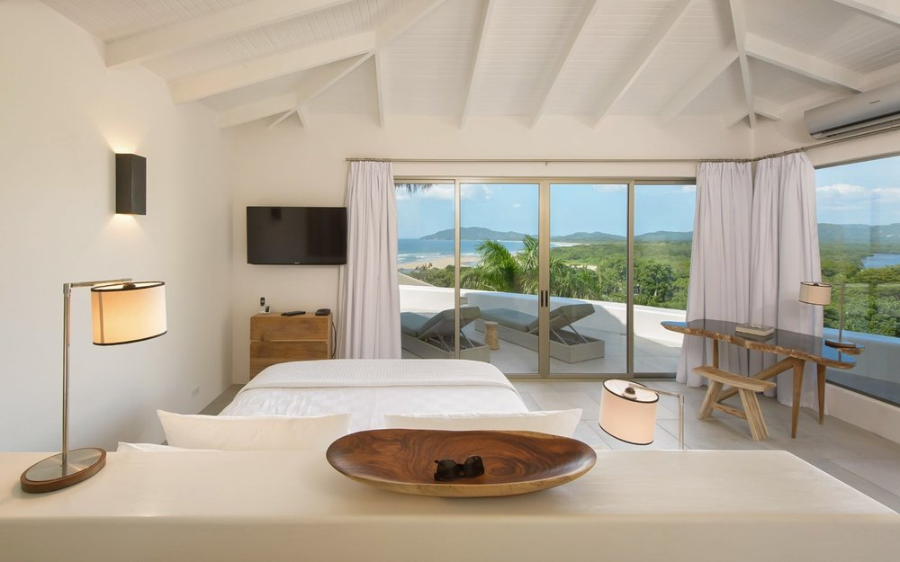 View from honeymoon suit bed of ocean at Sunset House in Tamarindo.