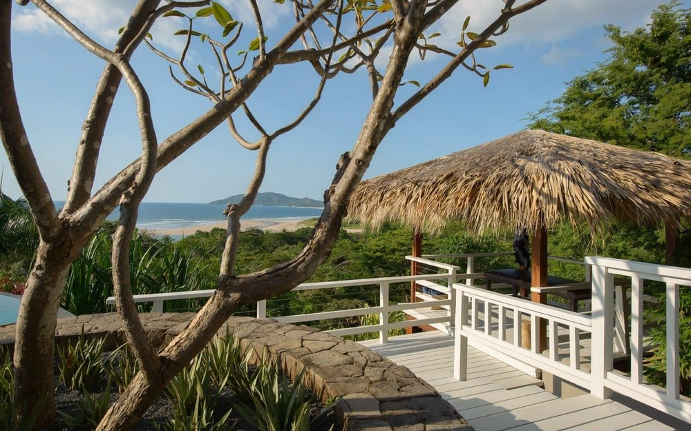 Covered area for small wedding ceremony with beach view.