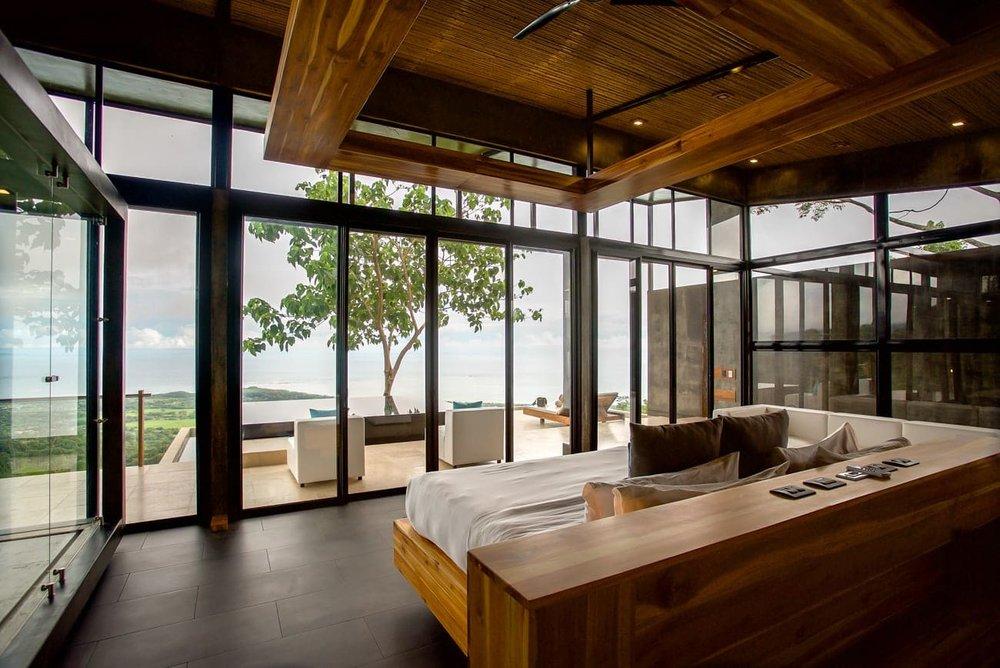 View of Pacific Ocean from master bed in Kura Hotel honeymoon suite.