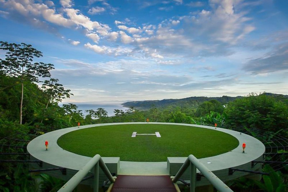 Helipad wedding ceremony site at Ocio Villas with ocean views.
