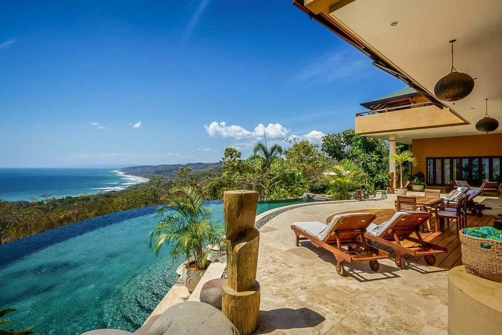 Area by pool with ocean views for weddings at Ocio Villas in Costa Rica.