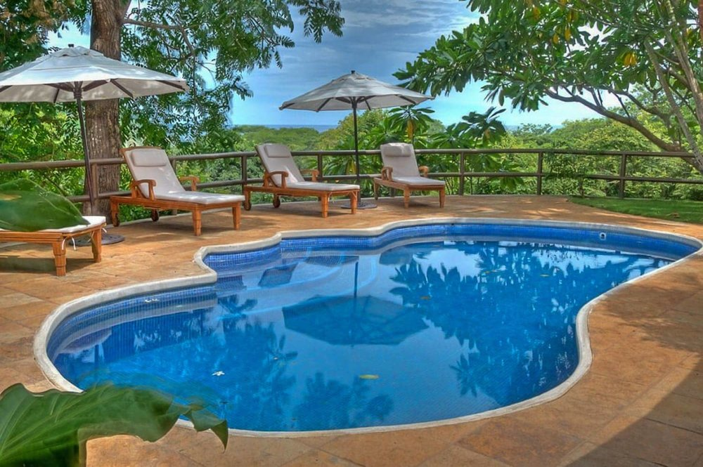 Amazing views of the Pacific Ocean and mountainous rainforest from Hacienda Barrigona's pool