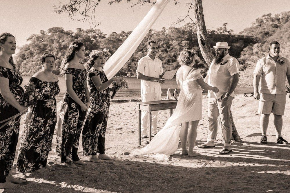 Black and white photo of beach wedding ceremony in Costa Rica.