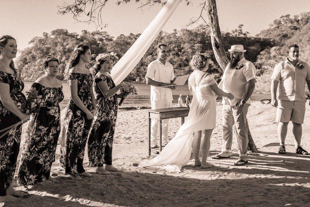 Black and white photo of beach wedding ceremony in Costa Rica.