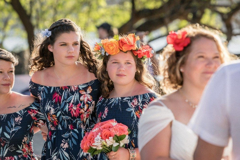 Bridesmaids get emotional as they watch their mother get married.