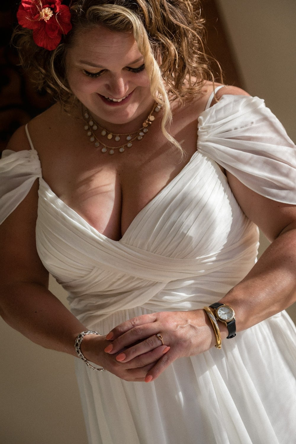 Bride in Costa Rica wearing white wedding dress looking at her ring.