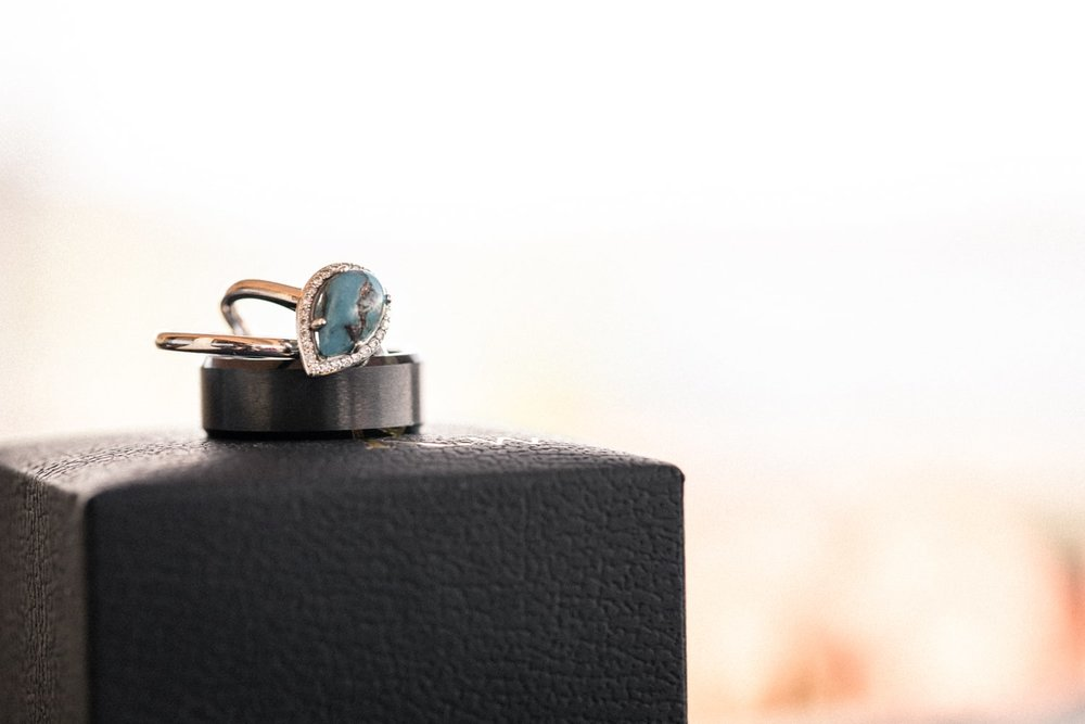 Wedding bands on jewelry box at bridal suite.