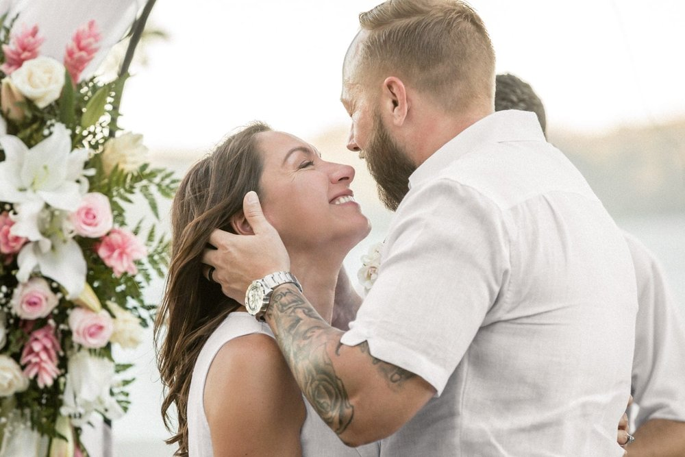Couple sharing an intimate moment after getting married in Costa Rica.