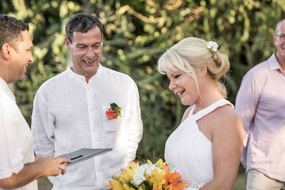 Couple at altar getting married at Occidental Papagayo in Costa Rica.