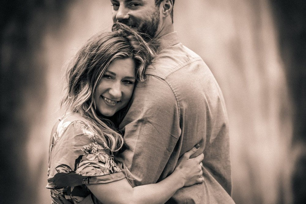 Gorgeous black and white photo of couple in love during waterfall engagement photo session.
