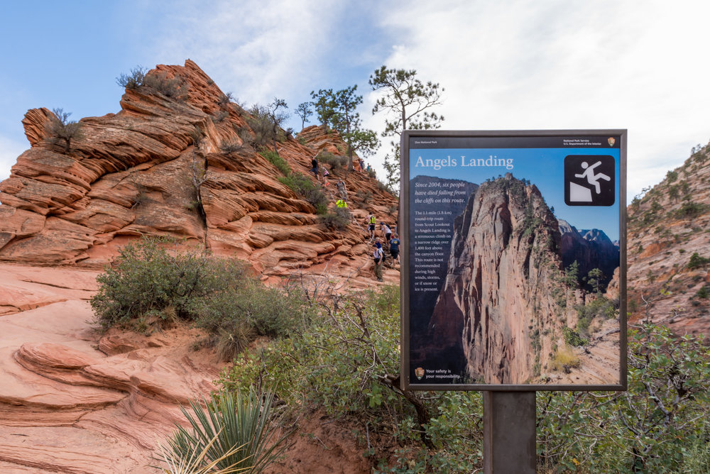 A sign at Scout Lookout explains the dangers of continuing to the top of Angels Landing. Six people have died from falling off the cliff since 2004.