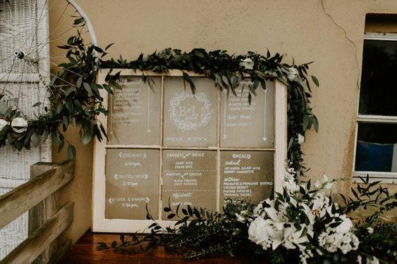 Rustic Wedding Idea Seating Chart Window.jpg