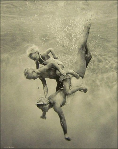 Esther Williams swimming with her children photo via Flickr/ Kat Dev