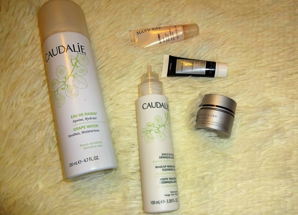 These 5 products have been my holy grail recently. (left to right) Caudalie Grape Water, Caudalie Make-up Removing Cleansing Oil, Mary Kay Satin Lips, Korres Black Pine Firming, Lifting, and Antiwrinkle Night Cream, and Estee Lauder Re-Nutriv   Quick Tips   A. Hydrate like your face depends on it. Hydrating the skin can help with dark spots and dryness. http://www.sephora.com/grape-water-P12045  B. Use a make-up removing oil to remove your make-up. Oils dissolve the make-up so that its not left in your pores to cake up and cause breakouts. http://www.sephora.com/make-up-removing-cleansing-oil-P401244