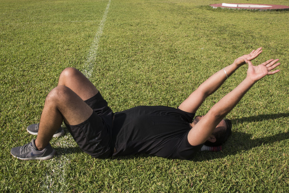 3. taking 20 seconds to slowly bring your arms down behind your by rotating the shoulders.