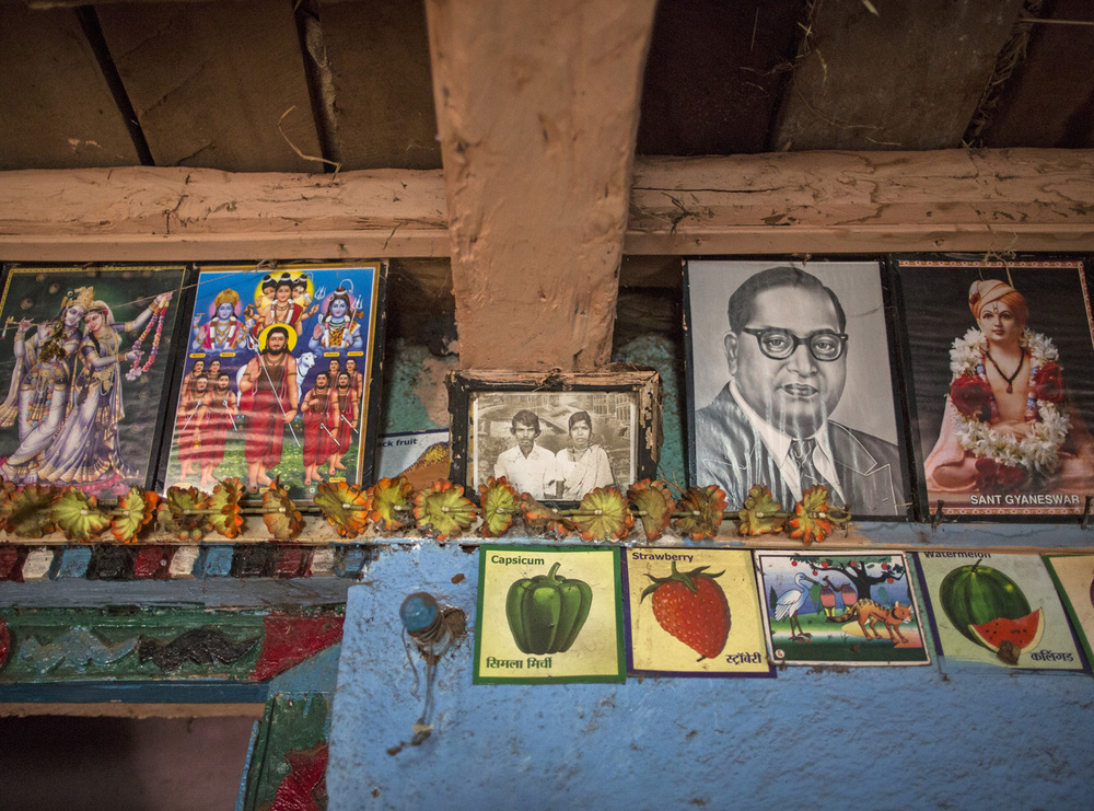 A old photo frame of Namdeo and Bagabai is seen on a wall inside their house in Denganmal village.