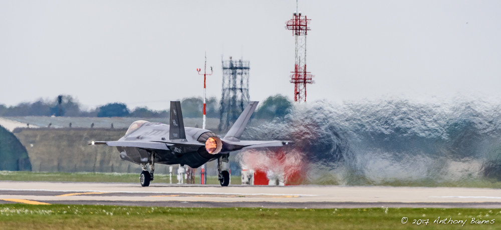 Piling on the gas: an F-35A leaves a trail of jelly air as its afterburner propels it along the runway