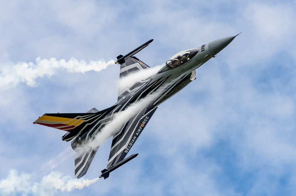 Vapour condenses as the Belgian display F-16 pulls a high G turn. The aircraft was moving very fast, so a high shutter speed keeps the picture sharp.      Nikon D810, Nikon 200-400mm f/4G VR II, 1/1600 sec, f/6.3, ISO 250, 400mm