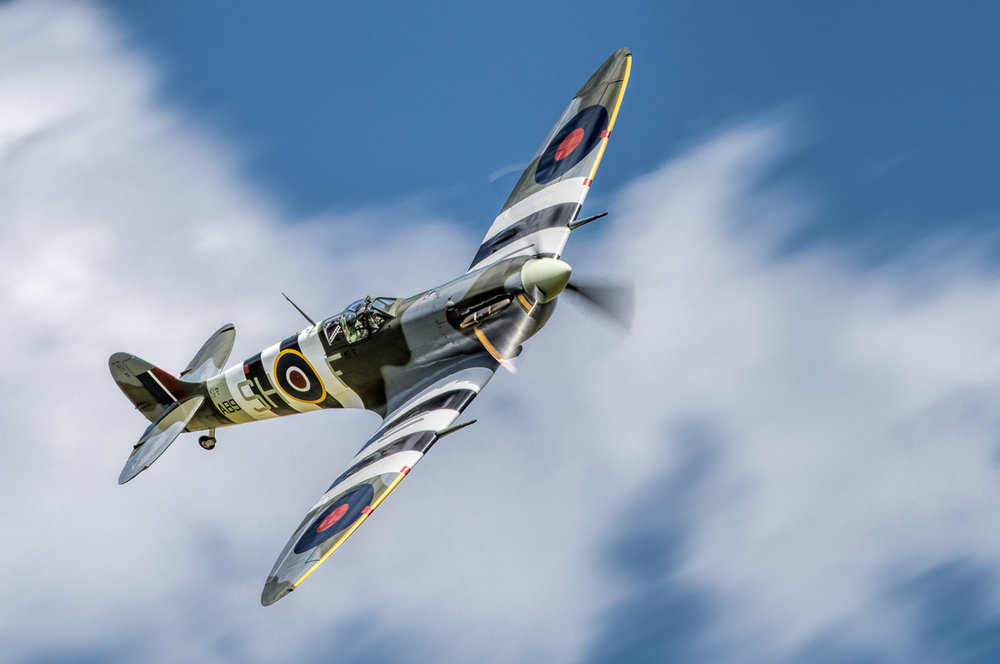 Spitfire Mk Vb AB910 of the Battle of Britain Memorial Flight. An example of a topside pass at a dynamic angle.      Nikon D810, Nikon 200-400mm f/4G VR II, 1/250 sec, f/8, ISO 200, 400 mm