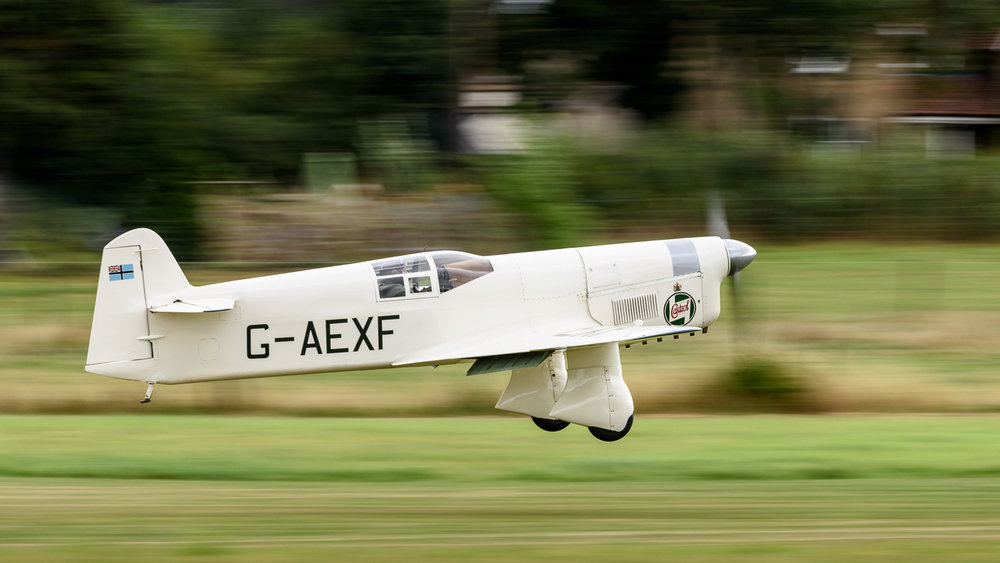 1936 Percival Mew Gull (G-AEXF). The slow shutter helps convey an impression of speed.      Nikon D810, Nikon 200-400mm f/4G VR II, 1/80 sec, f/10, ISO 200, 280.0 mm