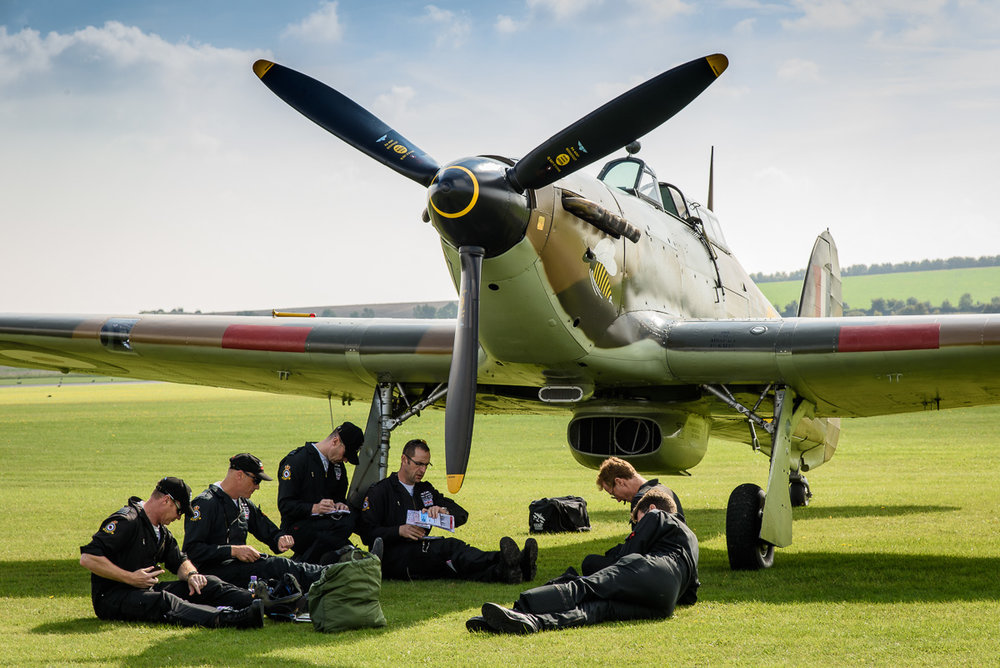 Battle of Britain Memorial Flight briefing. The personnel gather in the shade of one of their aircraft, a Hurricane.    Nikon D810, Nikon 24-120mm f/4G, 1/160 sec, f/11, ISO 200, 98.0 mm