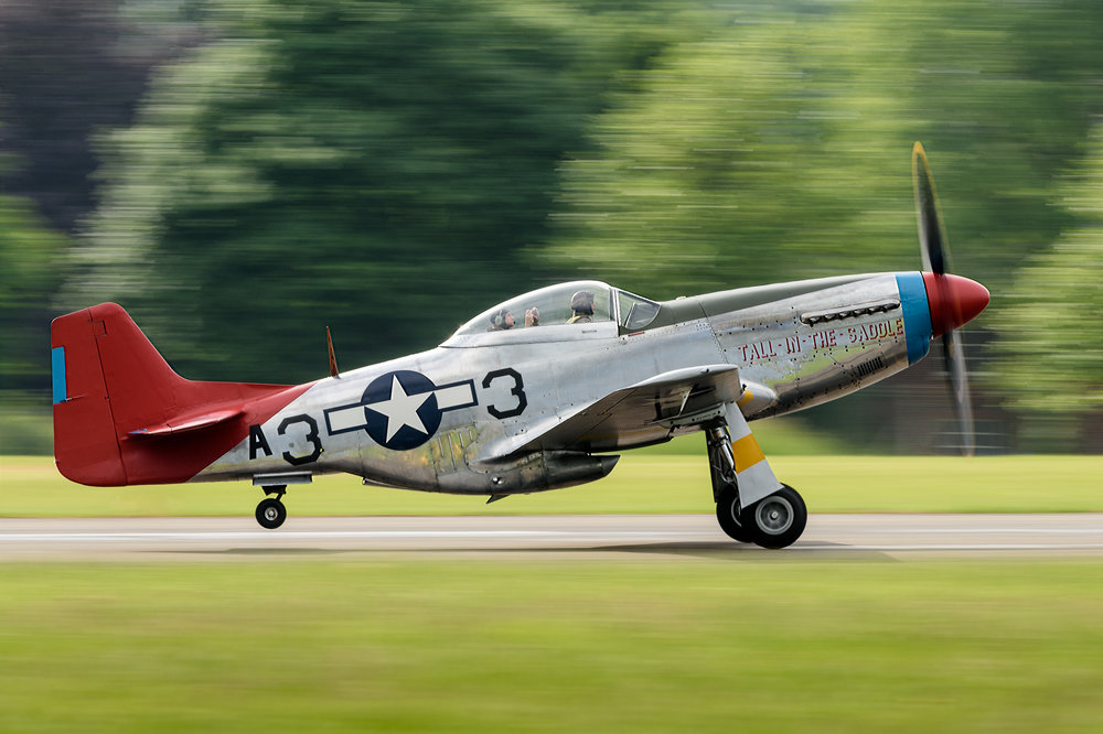 "P-51 Mustang ""Tall in the saddle"" takes off from Biggin Hill.      Nikon D810, Nikon 200-400mm f/4G VR II, 1/80sec, f/9, ISO 125, 280 mm"