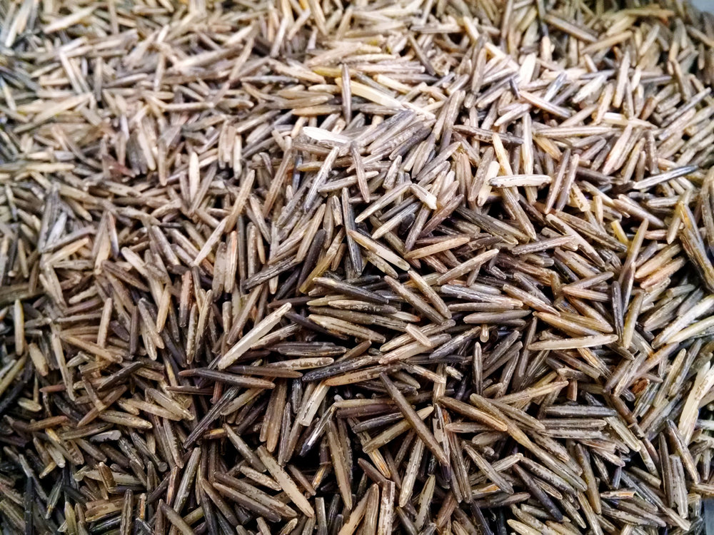 "An easy way to differentiate between ""real"" wild rice and commercially grown wild rice is by color and grain size. Real wild rice is lighter and more varied in color with longer grain."