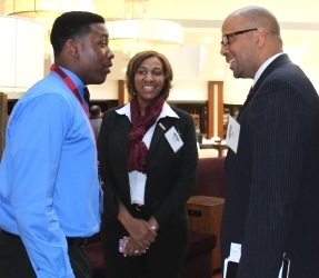 Left to right: Schmid Elementary School 8th grader Darnell and Principal Ron Simmons speak with Deputy Secretary Jim Shelton