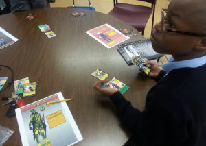 Student works during extended learning time on his superhero.