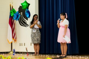Angie, a Martin Luther King, Jr. 6th grader, speaks at the school's WOW!
