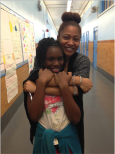 Georgina with her role model Teaching Fellow Ms. Evans.