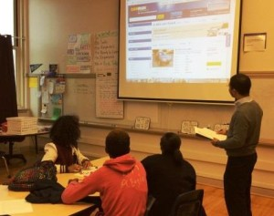 "Volunteer Citizen Teacher Seth Conyers teaches ""Game of Life"" to 8th grade students in Chicago"