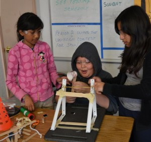 Students from Cesar Chavez Academy prototype a catapult