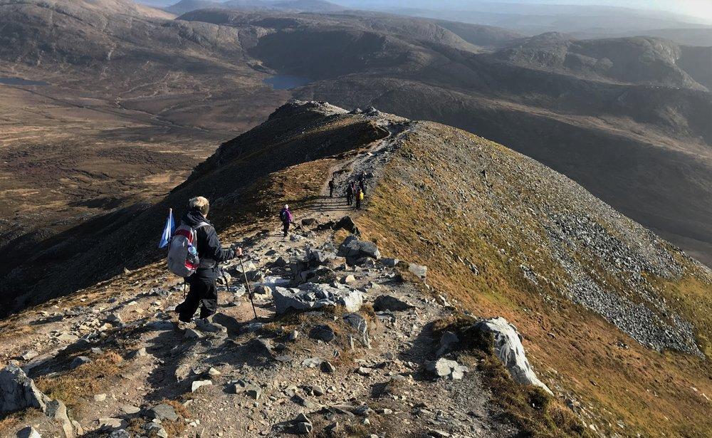 Descending along the narrow summit ridge of Errigal mountain.