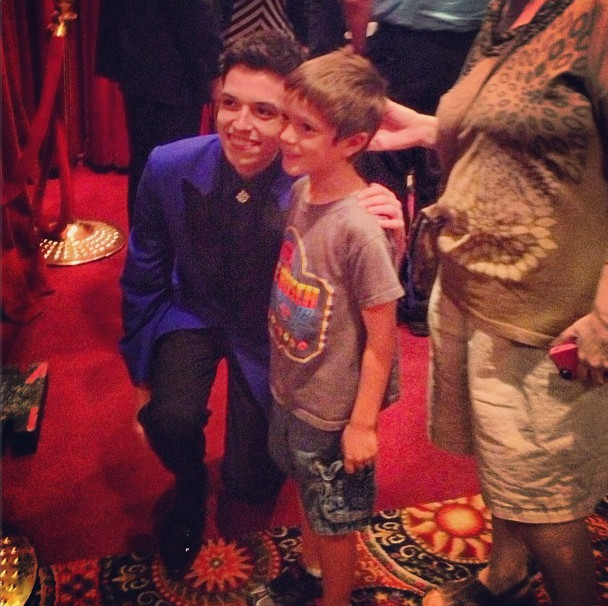 With a young fan after the show.