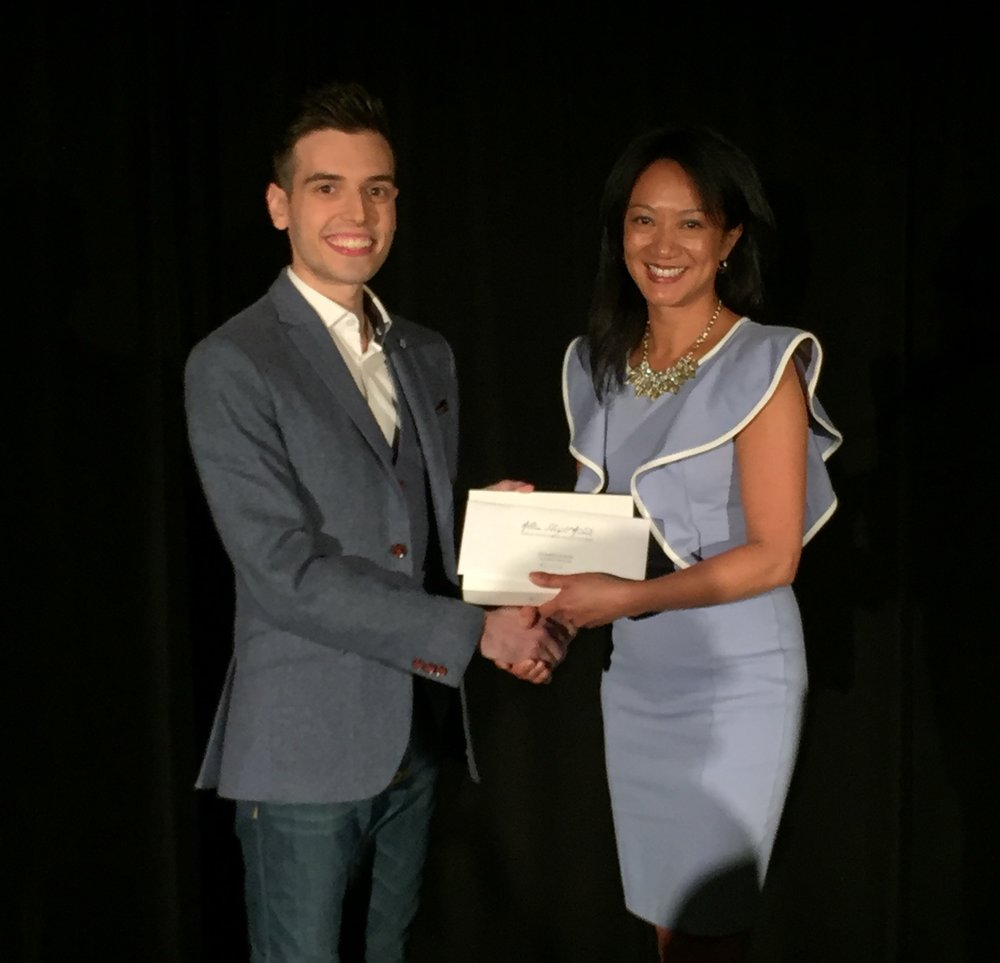Receiving the award from Julie Eng, Magicana Executive Director.