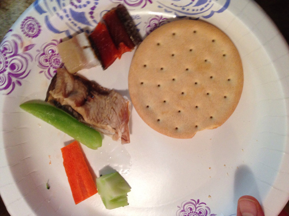 This is dried fish, raw veggies, cracker bread and Beluga whale.
